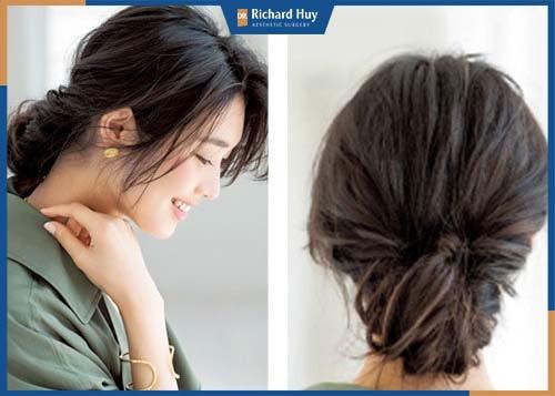 Kiểu tóc phồng búi ngược tạo điểm nhấn giúp che khuyết điểm cằm ngắn